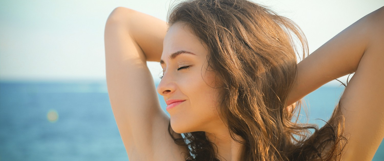 DMBeautiful woman relaxing with closed eyes on blue sea background_54273052_1