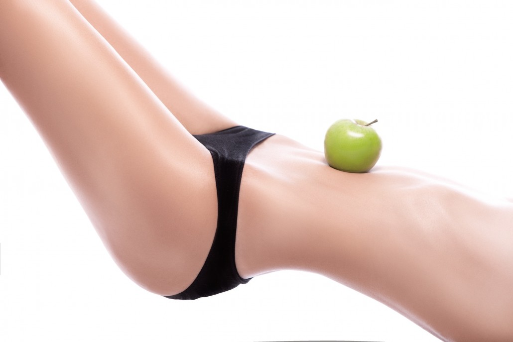 DMwoman holding a green apple on her belly_68744151