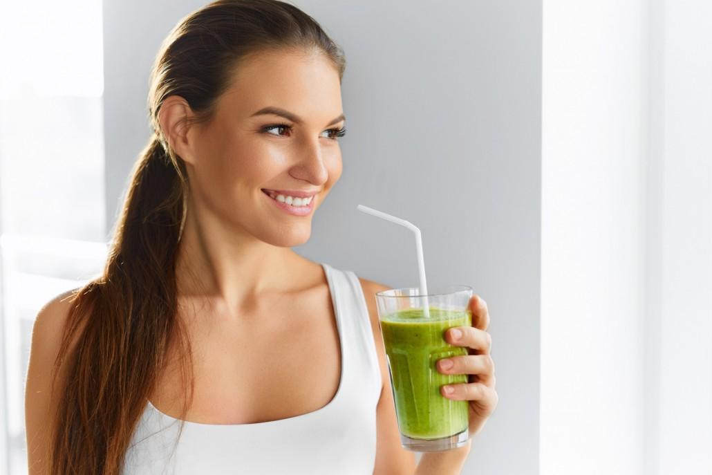 BM_Healthy Eating Woman Drinking Fresh Raw Green Detox Vegetable Juice_96241546