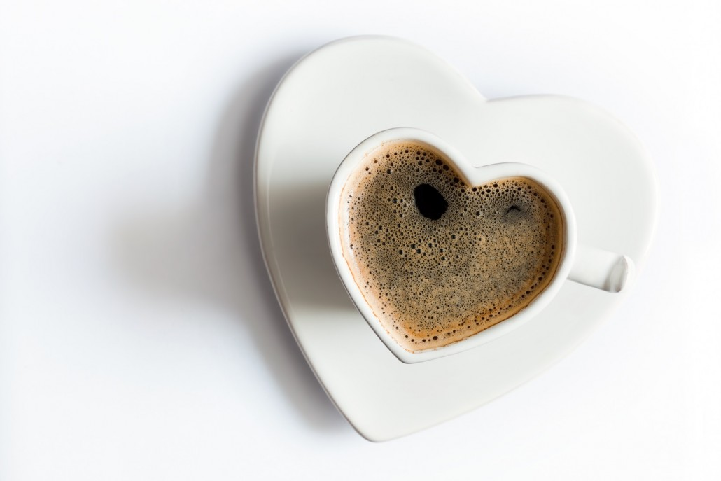 BM_Heart shaped cup of black coffee on white. Love_73874935