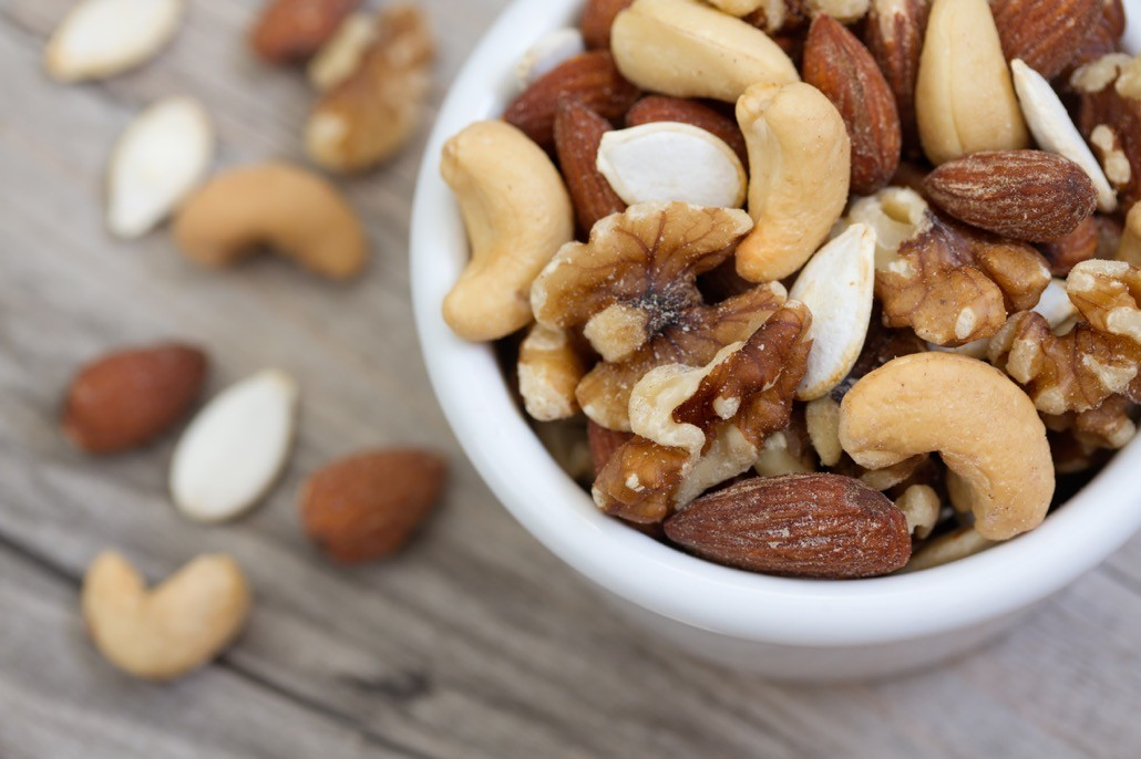 BM_Bowl of Mixed Nuts on Rustic Wooden Table_98745230