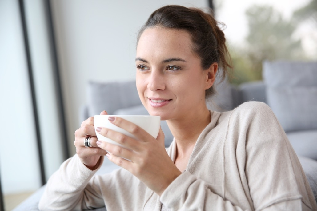 BM_Peaceful woman relaxing at home with cup of tea_57845518