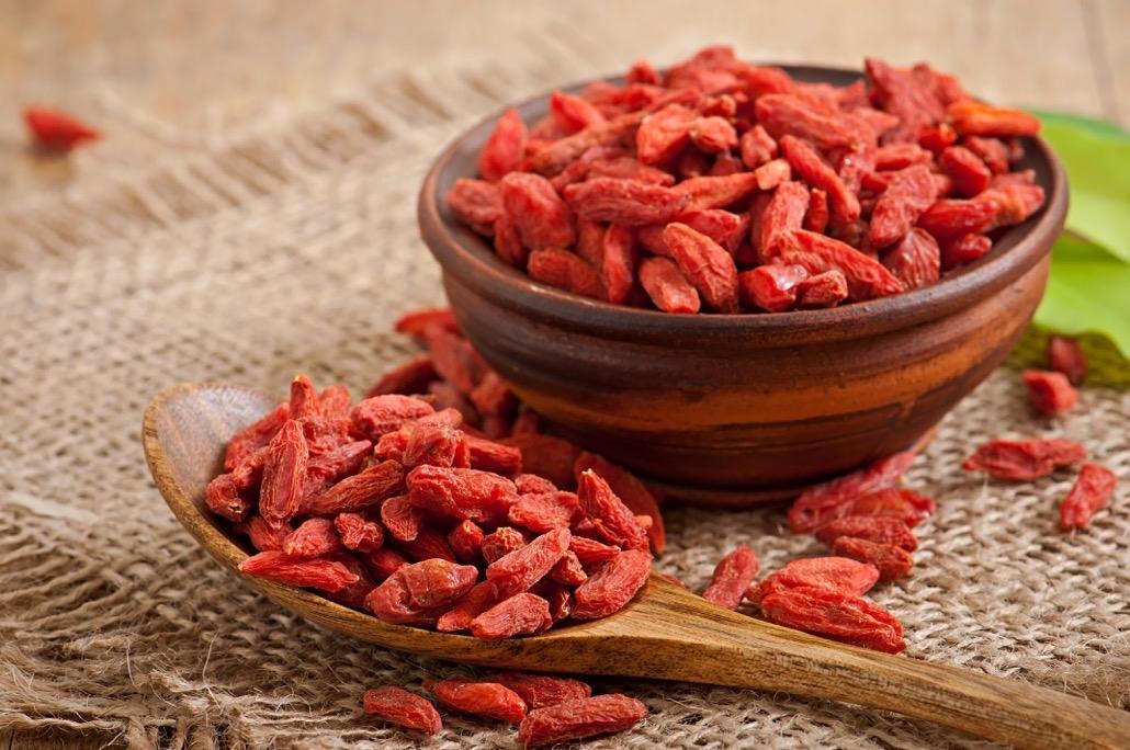 BM_Red dried goji berries in wooden spoon_72444704
