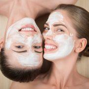 bm_two-beautiful-girls-applying-facial-cream-mask-and-beauty-treatm_69752233