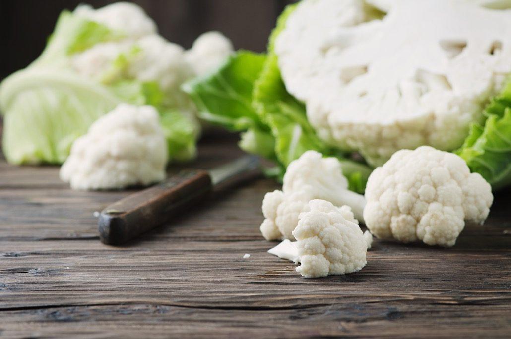 BM_Fresh raw cauliflower on the wooden table_100399656