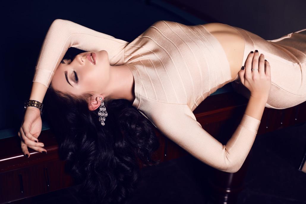 BM_beautiful woman with dark hair in elegant gold dress_77807971