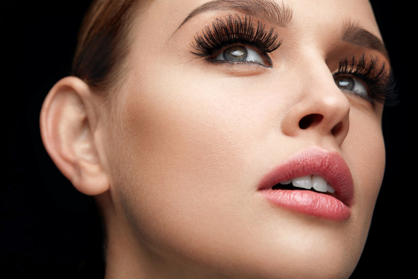 71353331 - fake eyelashes. portrait of beautiful sexy woman with professional makeup and smooth soft skin. female model with long black thick eye lashes, perfect eyebrows and beauty face. high resolution