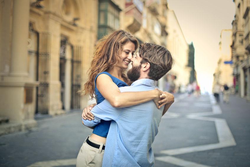 50742607 - in love man lifting hi girlfriend in a hug